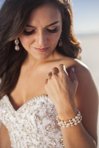 Engagement ring photo showing bride and wedding dress