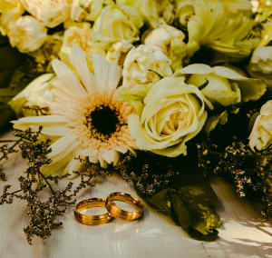 Custom rings sitting next to flowers
